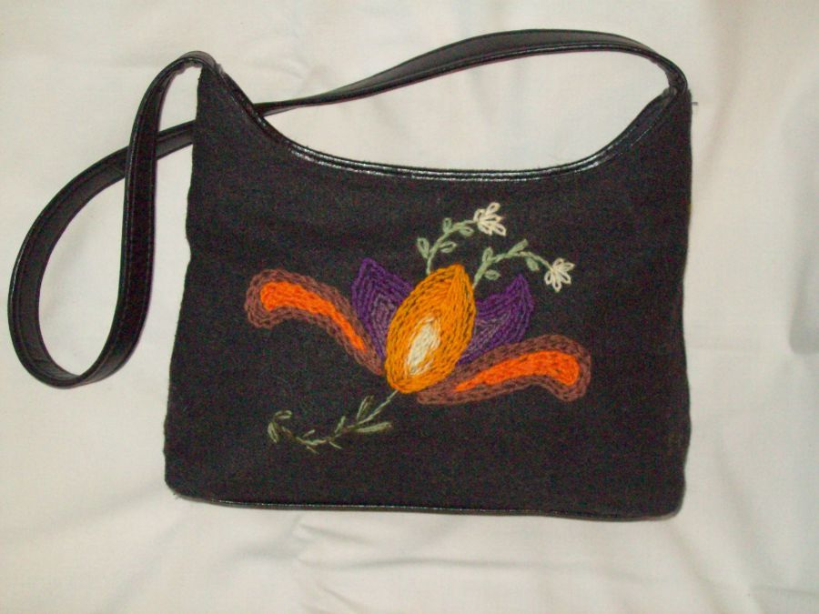 Black bag with embroidered flower motif